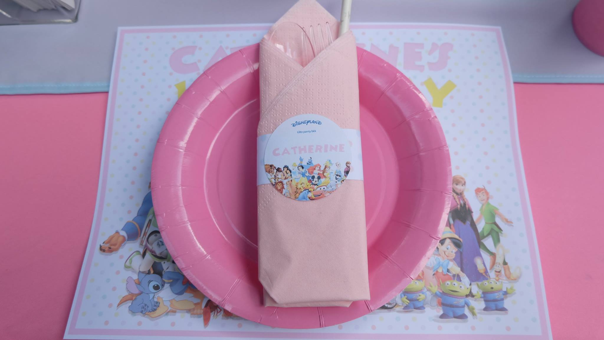 Cute birthday party in kids' favorite Disney themed decoration, backdrop, cake table, birthday cake and themed desserts